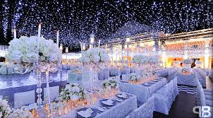 wedding reception ideas wedding with lots of candlelight and high topiaries