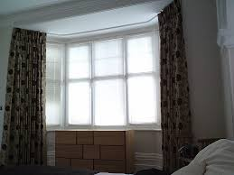 how to hang net curtains in a bay window gopelling