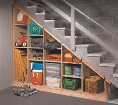 maximize that tricky under the stairs storage spot with these tips