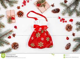 christmas bag with presents on holiday background with gifts fir