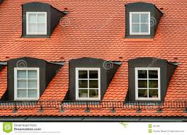 Dormer Building Red Tile Roof And Gabled Dormer Windows On Building In Munich