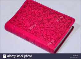 bible with a nice pink colored leather cover stock photo royalty