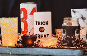 halloween candels last minute diy halloween candle centerpiece mod podge rocks