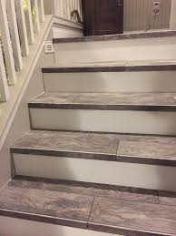 wood look tiled stair case water damage recovery pinterest