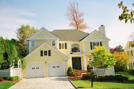 exterior briliant light yellow walling on the american home with