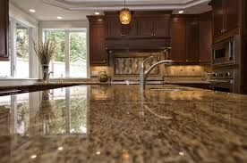 what to look for in a kitchen faucet countertops up look on gray granite kitchen countertops