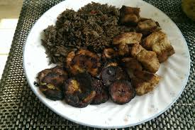 haitian griot and djondjon rice with fried plaintains and pikliz