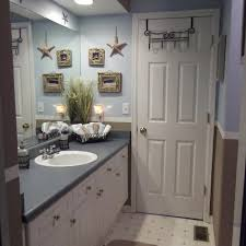 Seaside Bathroom Ideas Beach Themed Bathroom Towels Brown Varnished Wooden Vanity Cabinet
