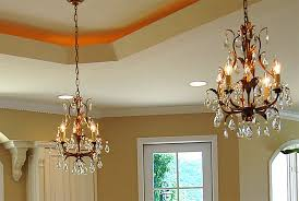 chandelier over kitchen island affordable luxury kitchen with