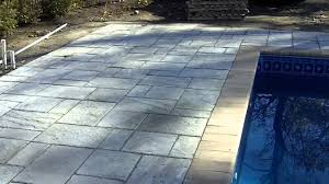 in ground vinyl liner pool with cantilever paver stone deck ma