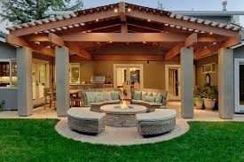 Fire Pit Rotisserie by White Stucco House Patio Traditional With Stone Fire Pit