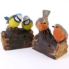 motion activated real sound tweeting singing birds on log garden