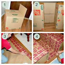 faux fireplace made from cardboard box holidays and crafts