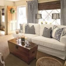 bookshelf between couch and door for end table landing strip