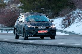 nissan leaf spy shots spyshots future nissan european hatchback spotted with less camo