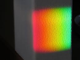 rainbow colors on the wall from a spectra rainbow anniversary
