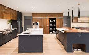 kitchen interior with two islands two sinks cabinets and