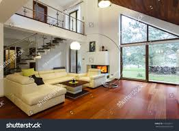 House Living Room by Designers House Entresol Spacious Living Room Stock Photo