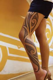 black polynesian design tattoo on full leg