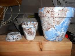 terra cotta pots using an easy marbling with spray paint and water