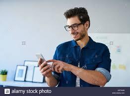 designer freelancer happy web designer freelancer using smartphone working from home