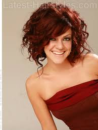 mid length hair cuts longer in front sassy red high volume curly style with long front pieces view 2 i