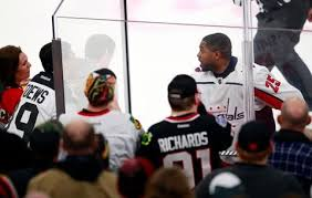 fan faces on a stick devante smith pelly of capitals faces remarks in penalty box