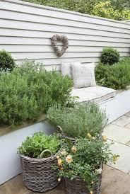 i love the idea of using baskets in soft grey rattan for planting