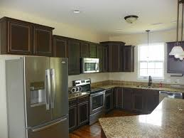bronze faucets for kitchen america s home place completed kitchen with granite and bronze