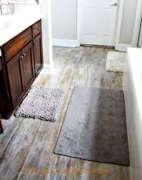how to pull up carpet and paint a subfloor to look like aged wood