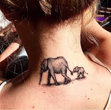 a mother and baby elephant my tattoo done by albert yelp