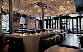wine glass chandelier at boarding house chicago rustic look for