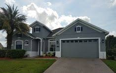 painting companies in orlando residential house painting contractor job completed brown with