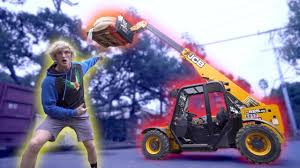 audi r8 tanner braungardt logan paul dropped giant pumpkin drop from 100 ft with jcb