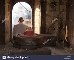local cremation local sitting a shiva lingam a cremation