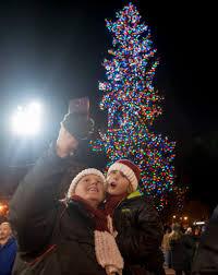 christmas tree lights up the night the columbian