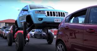 jeep grand cherokee modified watch this modified suv drive over traffic in a wild pr stunt