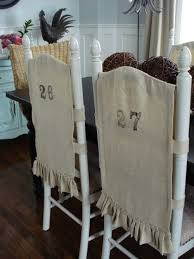 burlap chair covers although these are made of burlap i can see the potential to make
