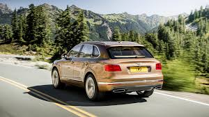 gold chrome bentley bentley gives the world its first ultra luxury suv wired