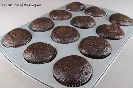 super moist chocolate cupcakes with vanilla buttercream frosting