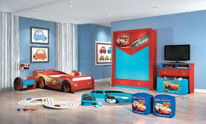 blue wall theme and red blue car wooden wardrobe next to red blue