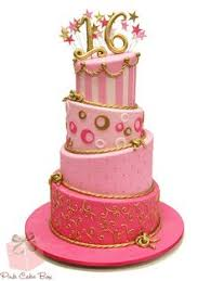 3 tier sweet 16 birthday cake in pink and purple with bow on top
