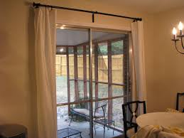 interior double sliding doors double white fabric curtains on black metal rod combined b sliding