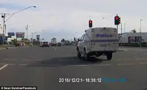 ran a red light camera queensland police van caught running a red traffic light in