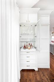 White Glass Cabinet Tall Cabinet With Pull Out Bar Tray Transitional Kitchen