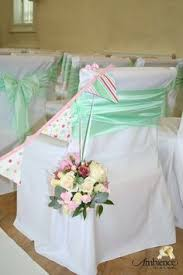mint chair sashes cadbury purple sashes and black chair covers for a wedding