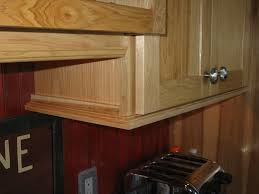 kitchen cabinete trim use crown molding and to make soffit look