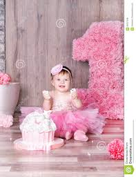 cute baby eating first birthday cake stock photo image