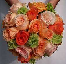 wedding flowers ireland shades of orange roses accented with green bells of