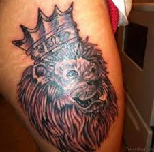 48 nice looking lion tattoos on thigh